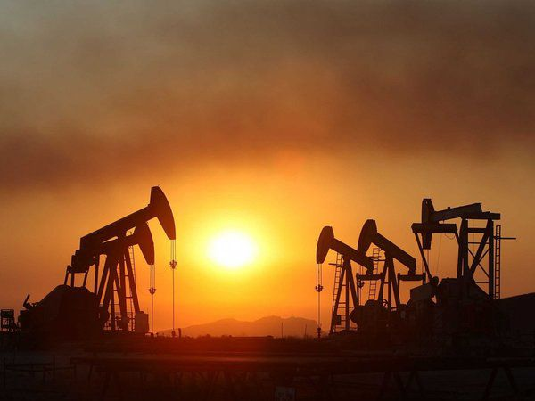 Investing Ideas Newsletter     - oil wells sunset full